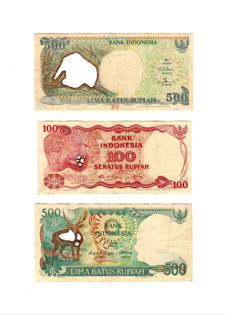 500, 100 and 500 Indonesian rupiah, 2019. Burnt bank notes mounted on cartridge paper. 28 x 20 cm.