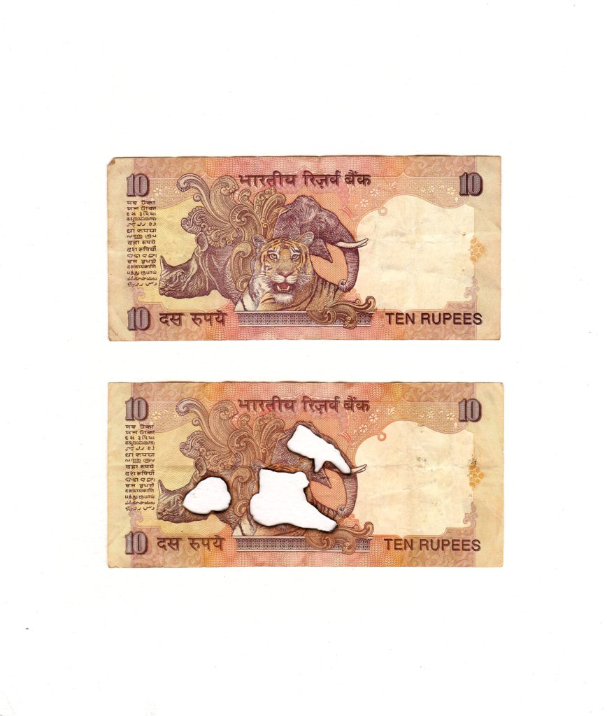 2 x 10 Indian rupees, 2019. Burnt bank notes mounted on cartridge paper. 25 x 22 cm.