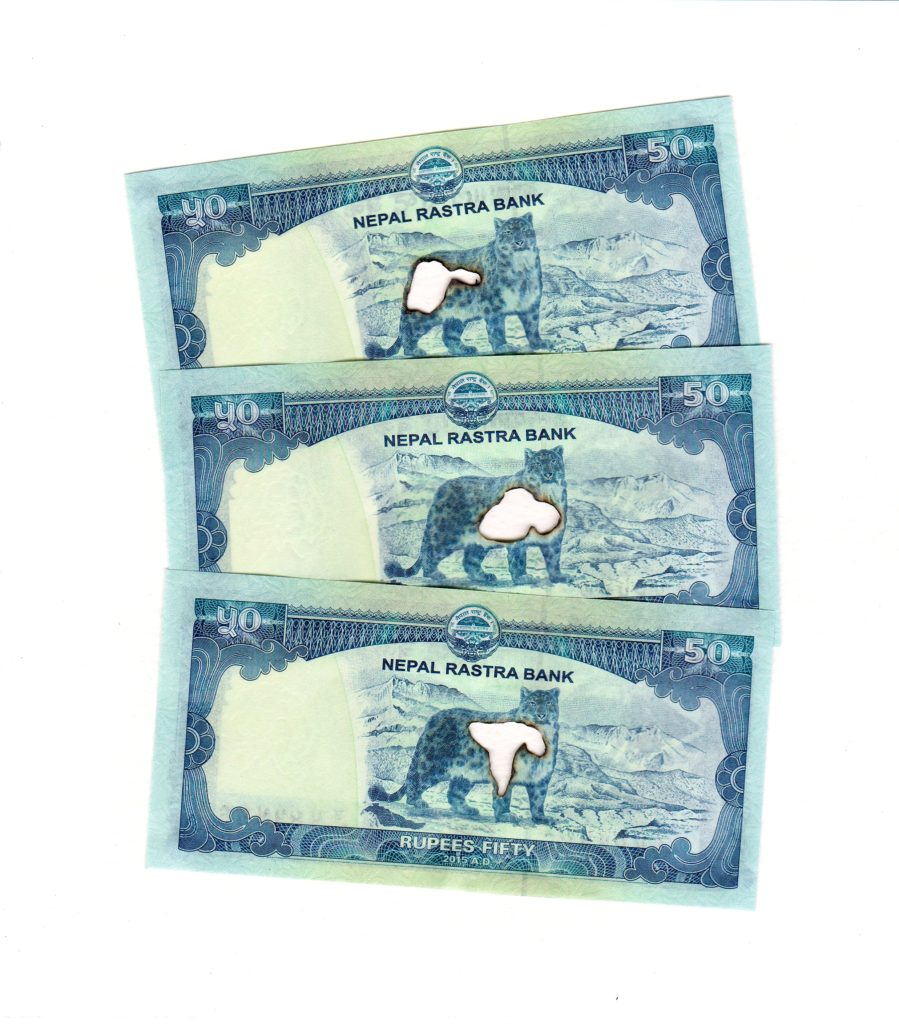 3 x 50 Nepalese rupees, 2019. Burnt bank notes mounted on cartridge paper. 24 x 21 cm.